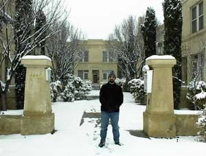 John in front of the courtyard, December at the Castle